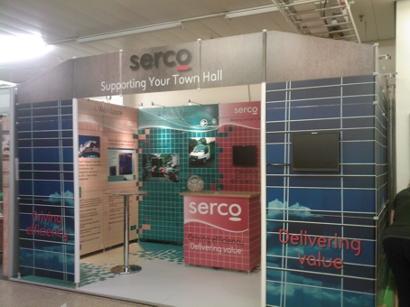 Exhibition stand with monitors mounted onto solid panels. All cabling runs underneath the floor.